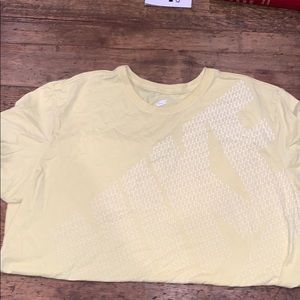 Yellow Nike shirt